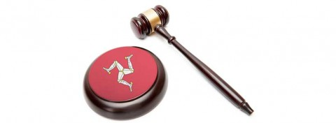 Isle of Man symbol and auctioneer's gavel