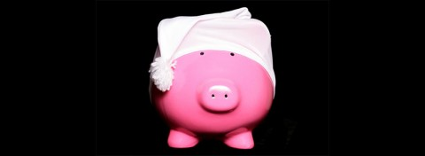 Dormant accounts - sleepy piggy-bank by Chris Brignell on Shutterstock.com