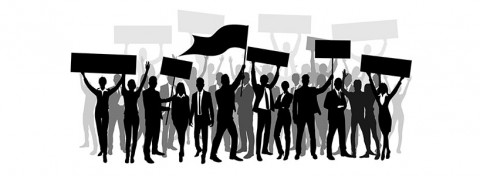 Protesting workers on strike - ProStockStudios on Shutterstock.com