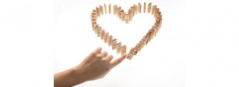 Heart-shaped dominoes toppling - Danm12 on Shutterstock.com