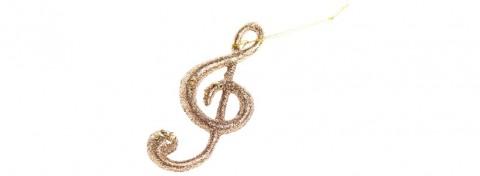 Christmas gold treble clef by Maryna Kulchytska on Shutterstock.com