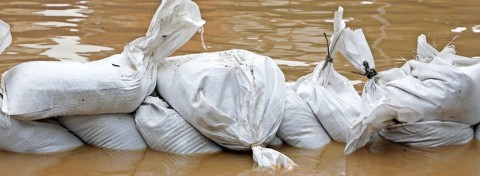 Sandbags in flood - ChiccoDodiFC on Shutterstock.com