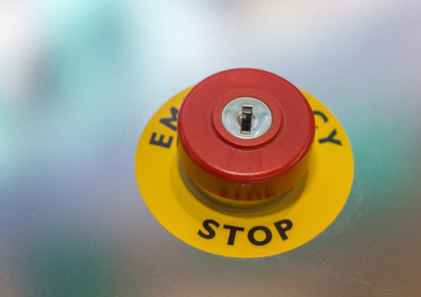 Emergency stop reset button by Serato on Shutterstock.com