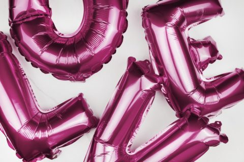 Large pink balloons in L-O-V-E letter shapes - photo: Rawpixel