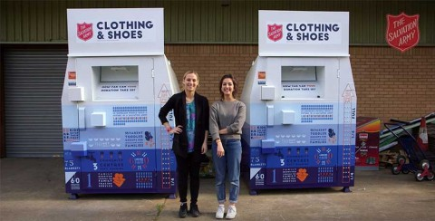 Two of the graduates who produced the new design for Salvation Army donated clothing banks.
