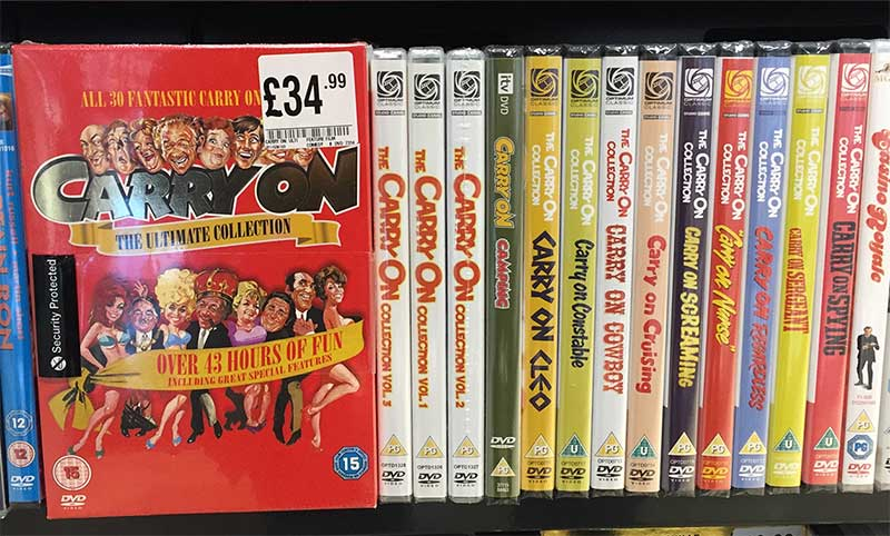 Carry On film DVD covers on a shelf
