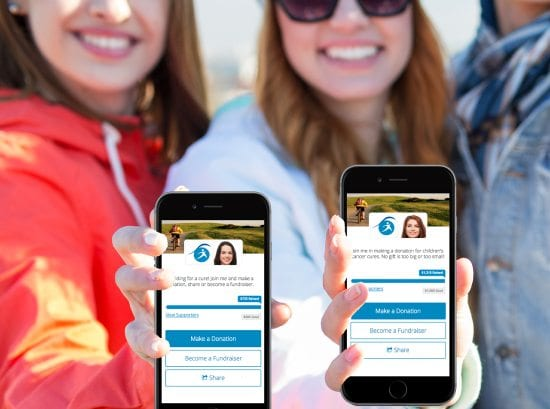 Group of smiling people showing fundraising campaigns on their mobile phone screens