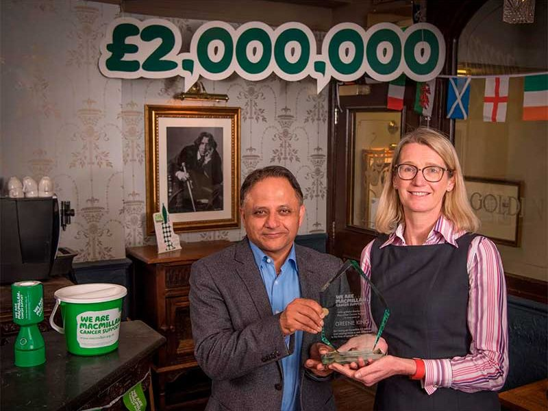 Rooney Anand and Lynda Thomas celebrate Greene King's support for Macmillan Cancer Support