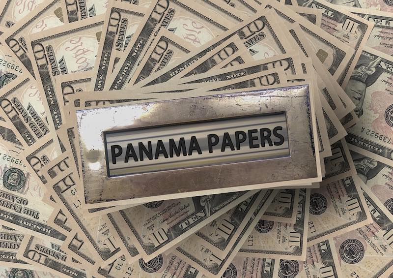 Panama Papers and dollar bills - photo: Pixabay