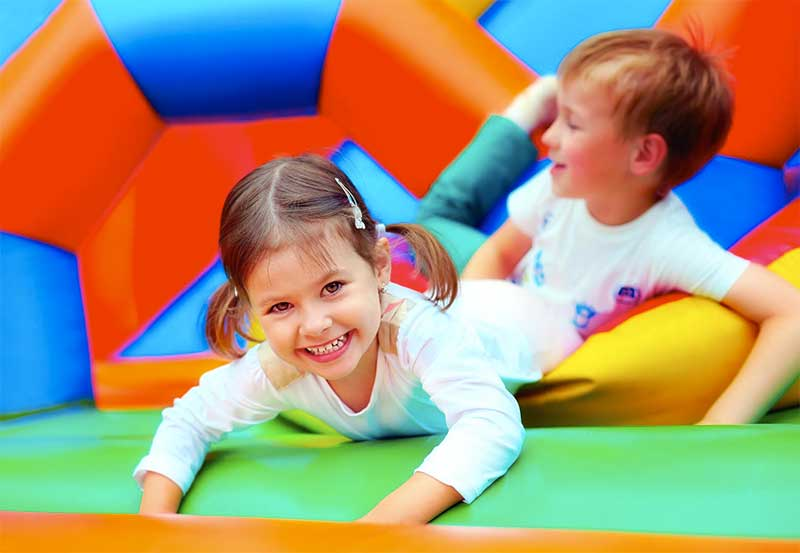 Image result for children on bouncy castle