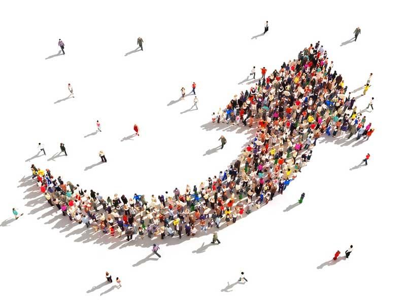 Crowd in the shape of an arrow - by Digital Storm on Shutterstock.com