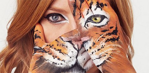 Sarah-Jane Mee with tiger hands for WWF Wear it Wild