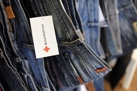 British Red Cross label on jeans in its charity shop