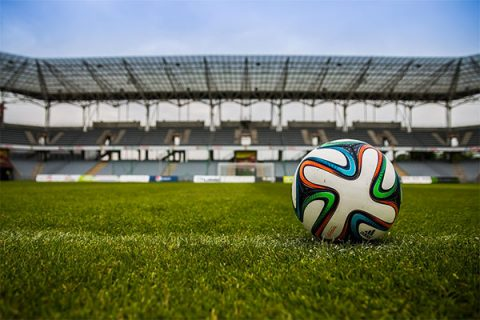 Football on the pitch in a stadium - Pixabay.com