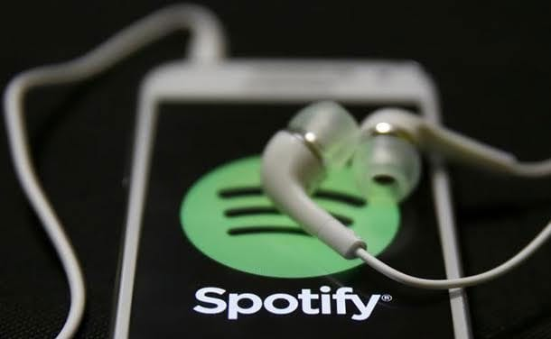 Spotify screen and ear buds