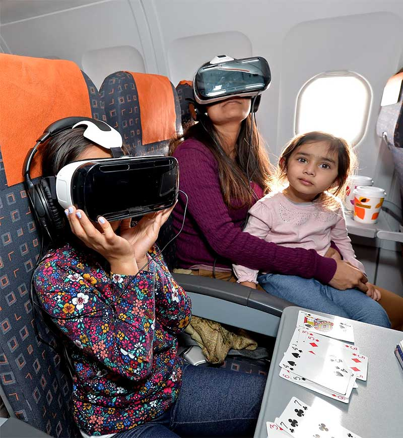 Passengers watch Unicef's virtual reality video about polio as they fly to Portugal