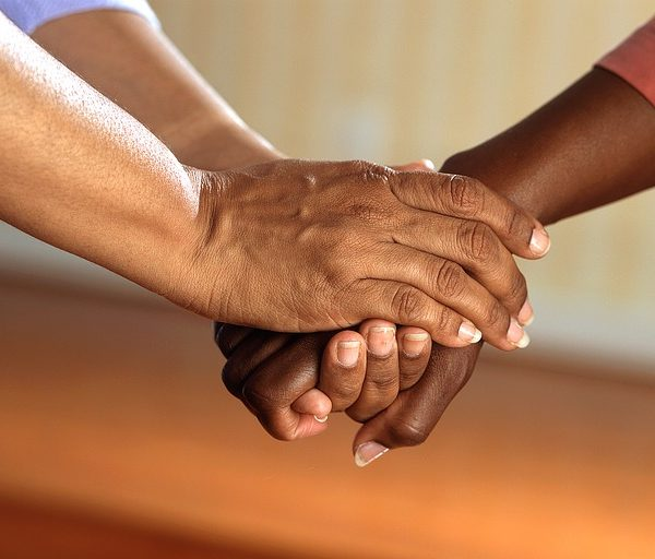 clasped hands holding hands