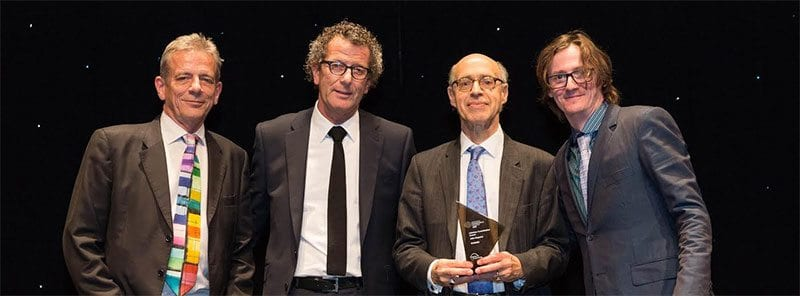 John Baguley receives award from Ed Byrne