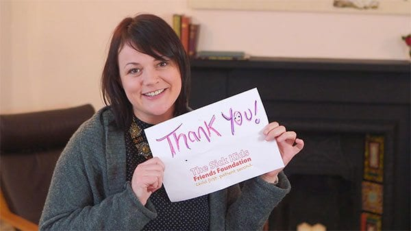 SKFF CEO Roslyn Neely with thank you sign