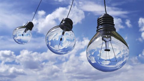 Lightbulbs against blue sky background - image: pexels.com