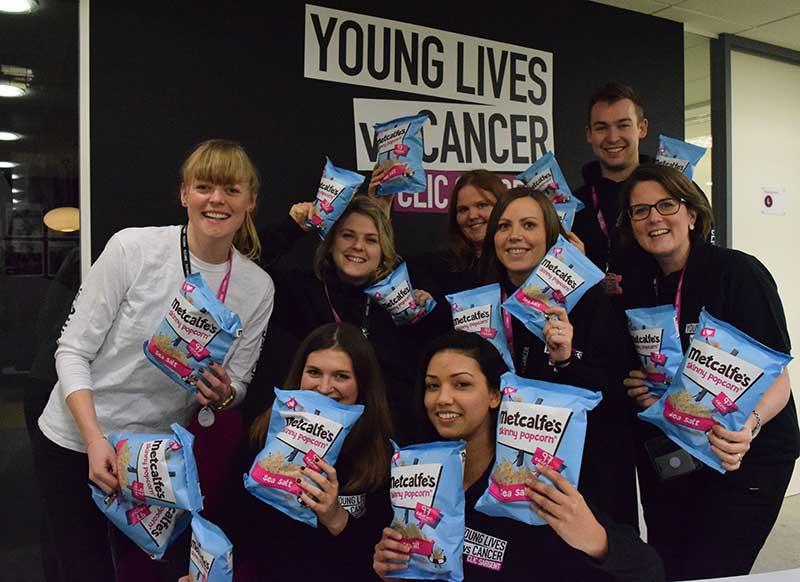 CLIC Sargent staff celebrate Metcalfe's popcorn fundraising total