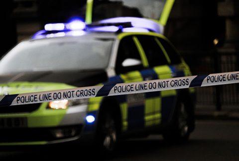 Police car and 'do not cross' tape - photo: Unsplash.com