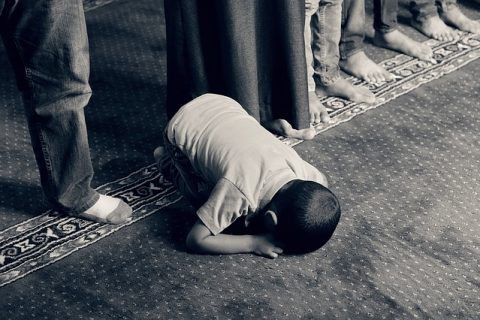 Young boy praying in a mosque. Photo: Pixabay.com