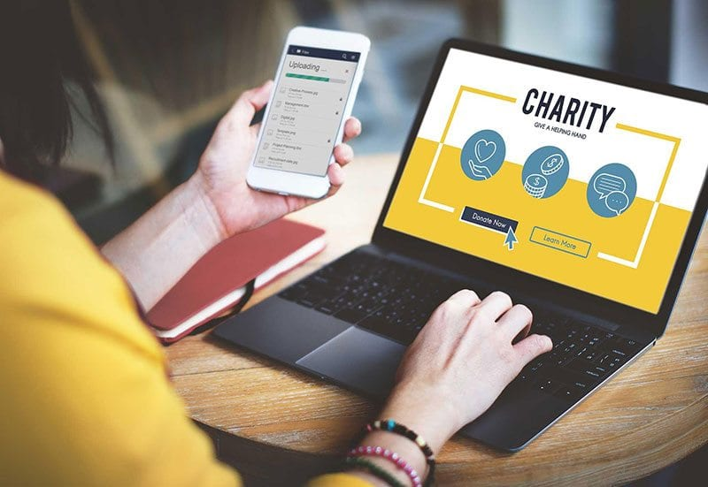 Donating to charity via laptop or mobile