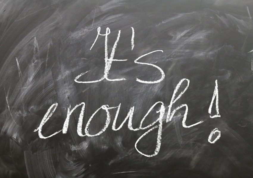 It's enough - chalk message on blackboard