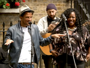 Peter Andre busks for Shelter