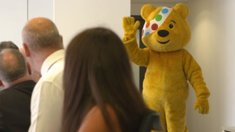 BBC Children in Need's mascot Pudsey Bear waving