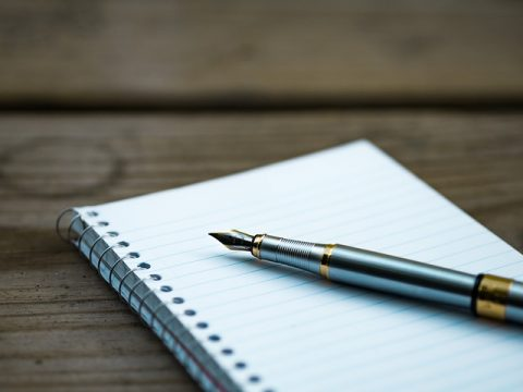 making notes with pen and notepad