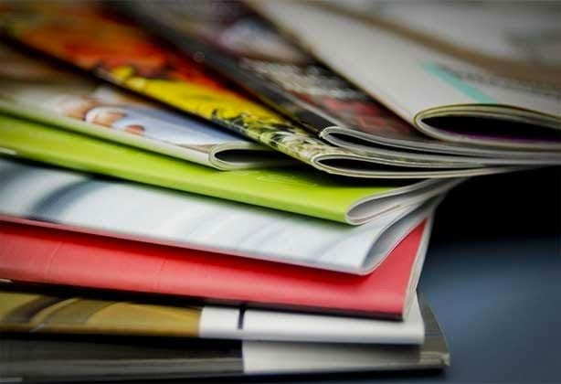 Printed magazines arranged in a fan