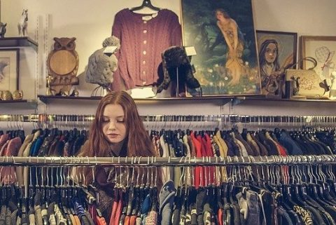 woman browsing in a charity shop
