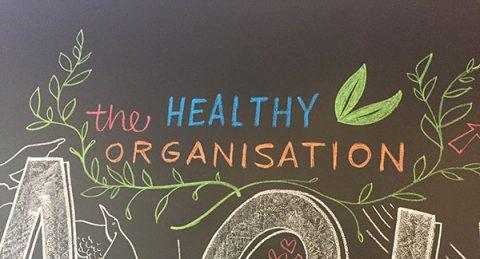The Healthy Organisation (written in coloured chalks)