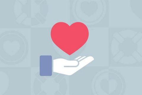 Facebook hand holding a heart