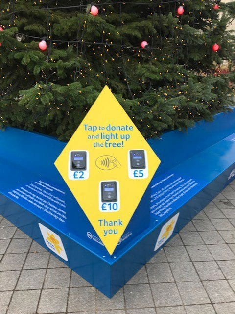 Tap to donate at #LightUpXmas Marie Curie Christmas tree on London's Southbank