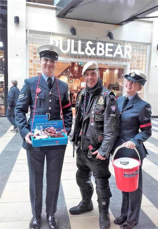 Poppy appeal collectors in military uniform