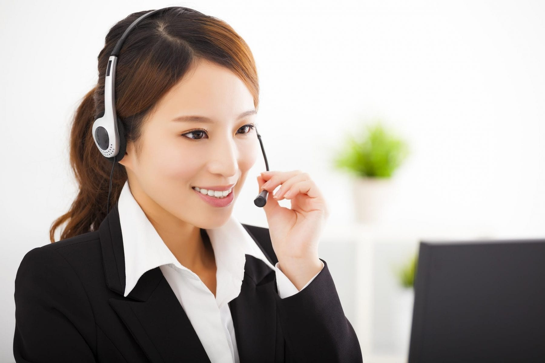 Customer service - woman with headphone and mic