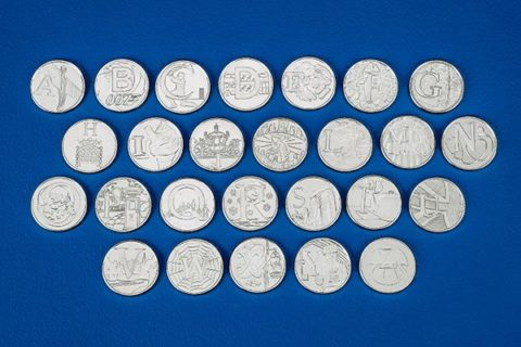 26 A-Z 10p coins laid out in four rows. Image: The Royal Mint