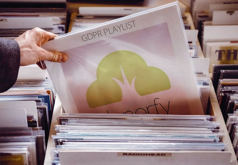 A Donorfy logo on a vinyl record being selected in a store