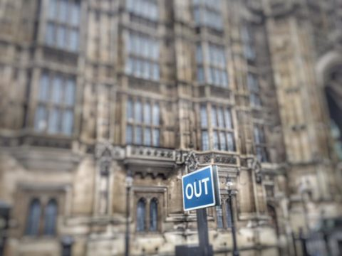 Out sign outside Houses of Parliament. Symbol of Brexit? Photo: Howard Lake