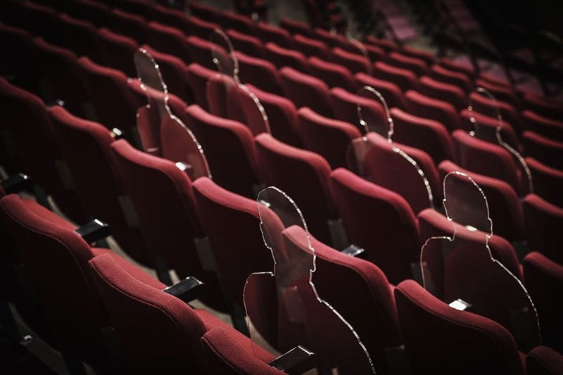 There But Not There silhouettes in theatre seats