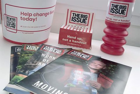 Big Issue collecting tins and bucket