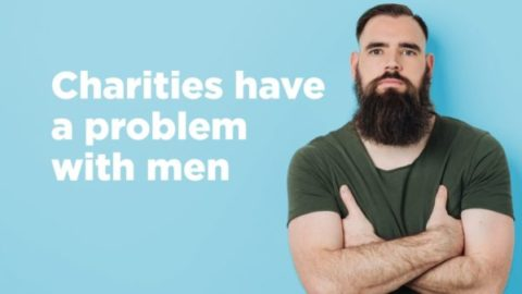 Charities have a problem with men - text next to bearded man folding his arms
