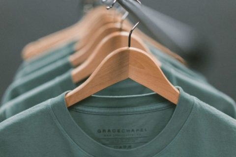 T shirts on clothes hangers - photo: Unsplash