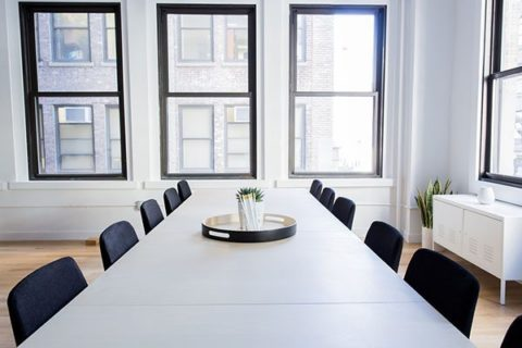 Empty chairs at an office table