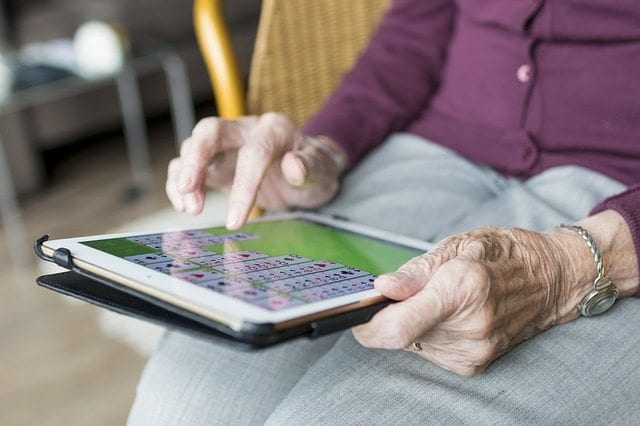 elderly person on ipad
