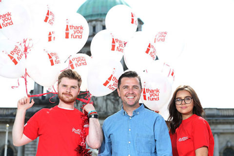 Pictured at Belfast City Hall is Thank you Fund supporter Pete Snodden with Sean Lewis and Amy Irwin from Youth Action NI