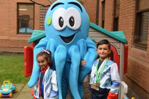 Ruben and Elena Evans-Guillen with Warrington Hospital Charity Mascot